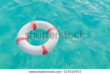 Lifebuoy  in swimming pool - stock photo