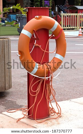 Lifebuoy on a rack in the port. - stock photo