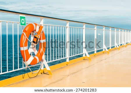 Lifebuoy on the deck of cruise ship - stock photo