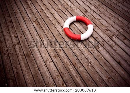lifebuoy, red stripes, - stock photo