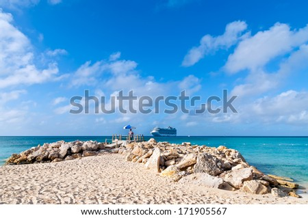 Lifeguard at the beach and cruise ship on the horizon, tropical Vacation Cruise. - stock photo