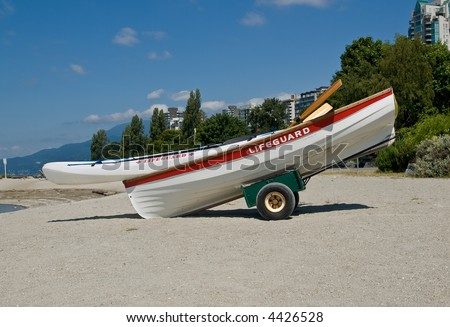 lifeguard boat on the beach - stock photo