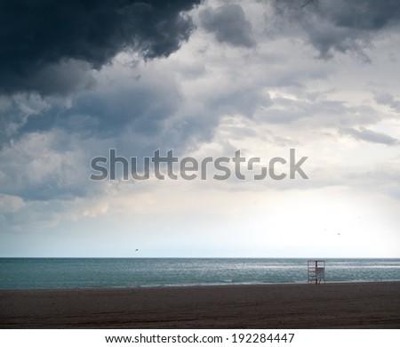 lifeguard chair on the beach - stock photo