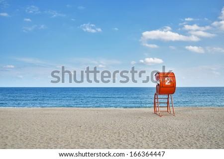 Lifeguard tower and sandy beach - stock photo