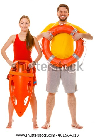 Lifeguards with rescue tube and ring buoy lifebuoy. Man and woman supervising swimming pool. Accident prevention. - stock photo