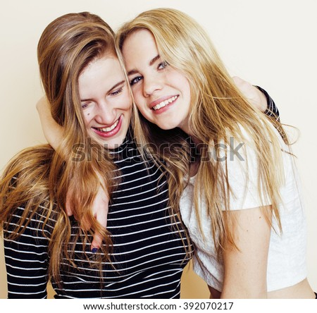 lifestyle and people concept: Fashion portrait of two stylish sexy girls best friends, over white background. Happy time for fun. - stock photo