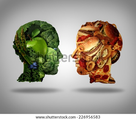 Lifestyle choice and dilemma concept as a two human faces one made of fresh green vegetables and fruit and the other head shaped with greasy fast food and fried foods as a symbol of nutrition. - stock photo