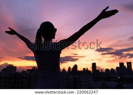 Lifestyle concept - beautiful happy woman enjoying summer outdoors - stock photo