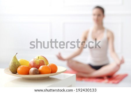 Lifestyle. Cute, attractive woman during yoga exercise - stock photo