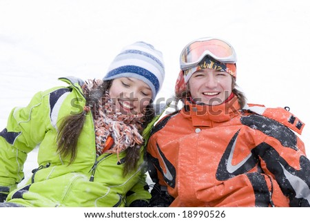lifestyle image of two young a snowboarders - stock photo