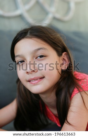 Lifestyle portrait of a young girl in a modern home. - stock photo