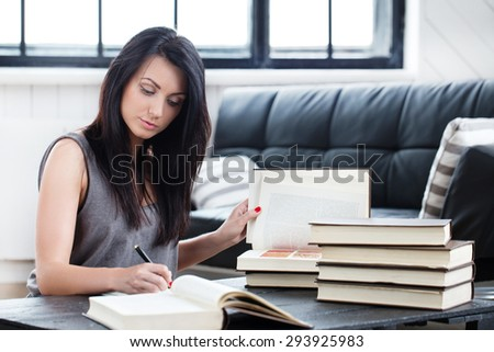Lifestyle, study. Beautiful girl with a book - stock photo