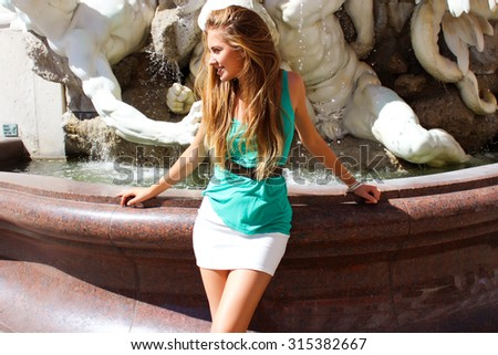 Lifestyle stylish full portrait of trendy woman posing near monument.Old city street,city life,traveling person,trendy girl,long blonde hairs,Italian,Rome.Traveling,Urban ,fashionista,street style - stock photo