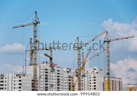 Lift crane building a new residential building - stock photo