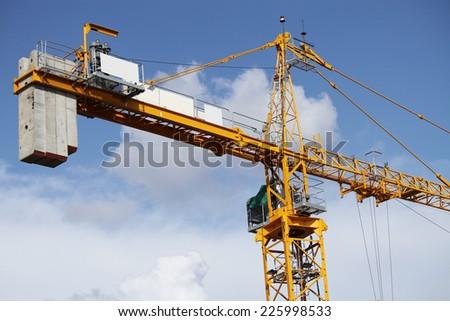 Lifting crane in construction site of concrete bridge. - stock photo