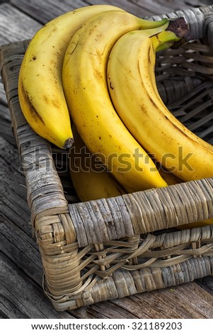 Ligament large ripe and fragrant bananas on wooden background. - stock photo