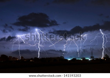 Lighning bolt over night sky in central europe - stock photo