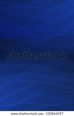 Light and dark blue flowing or wavy abstract design in vertical format - stock photo