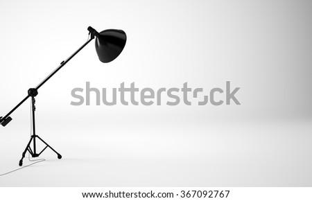 Light and empty studio room with black lamp, nobody. 3d render - stock photo