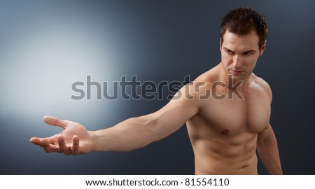 Light and power concept - creative muscular man holding bright sphere - stock photo