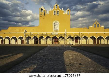 Light and shadows of the yellow monastery, Izamal, Yucatan, Mexico - stock photo