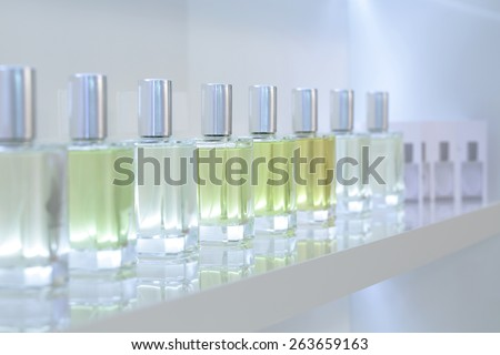 light and stylish luxury perfume store with famous fragance - stock photo