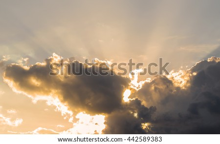 Light and sunset in evening with Dark clouds before thunderstorm and rain. - stock photo