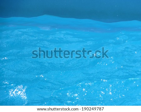 Light and water On the water in the swimming pool are paintings of light.  - stock photo