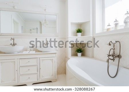 Light bathroom with two sinks and big mirror - stock photo