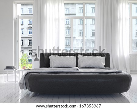 Light Bedroom Interior with black king-size bed - stock photo