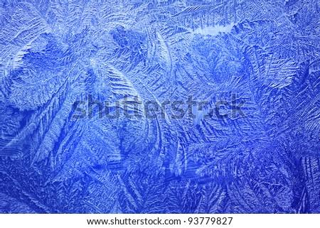Light blue frost pattern on a winter window - stock photo