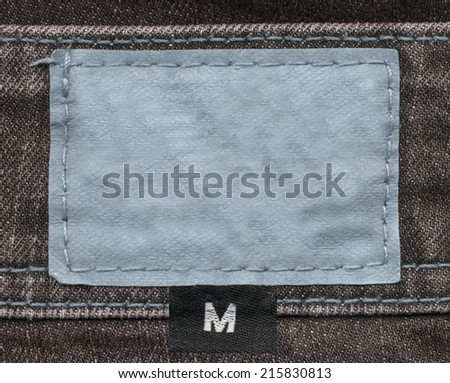 light blue  leather label on jeans background - stock photo