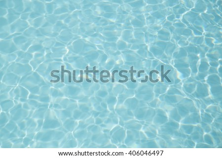 Light blue pool backgrounds with a rippled water texture - stock photo