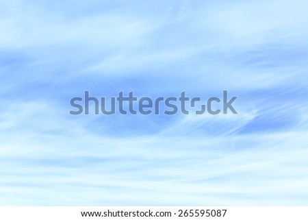 Light blue sky with cirrus clouds - abstract background - stock photo