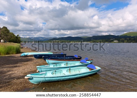 Light blue wooden dinghy rowing boats in the Lake District Ullswater Cumbria England UK - stock photo