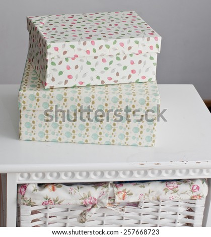 Light boxes on the white bedside table - stock photo