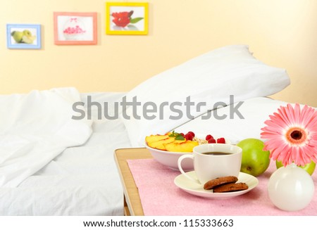 light breakfast on the nightstand next to the bed (images on background are from my portfolio) - stock photo
