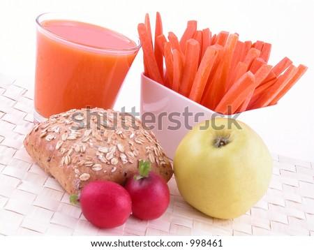 light breakfast - roll apple juice and fresh carrots - stock photo