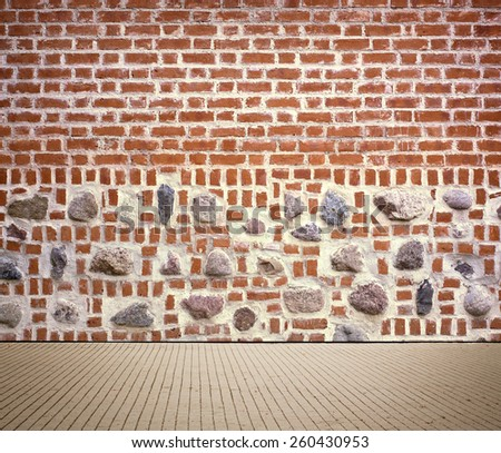 Light brown brick wall texture with sidewalk. - stock photo