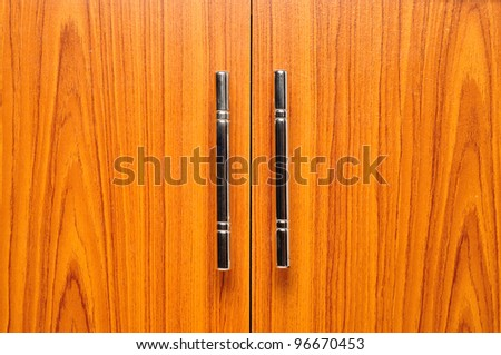 light brown doors with metal handles - stock photo