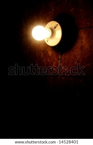 light bulb against a dark background vertical - stock photo