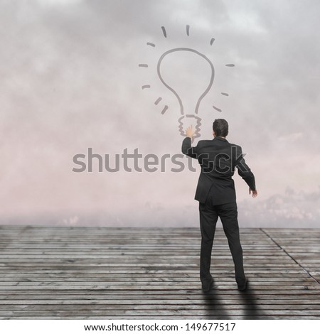 Light bulb and hand - new idea concept - stock photo