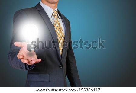 Light bulb in businessman s hand - stock photo