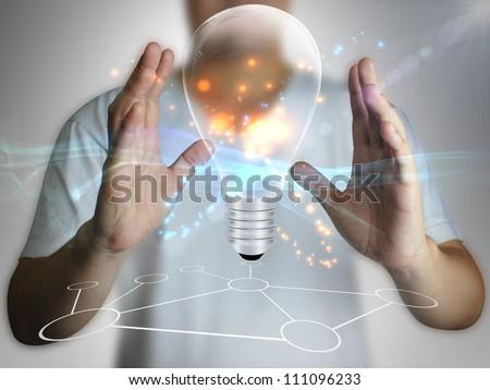 Light bulb in hand - stock photo