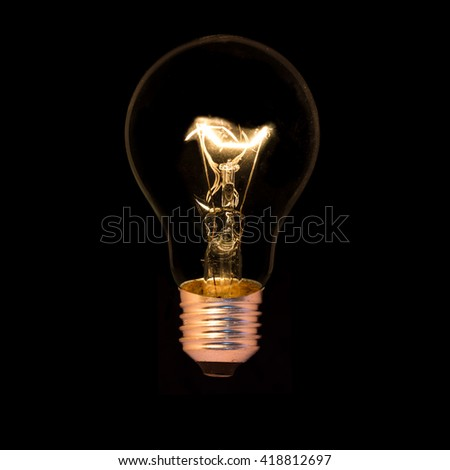 Light bulb isolated on a black background - stock photo