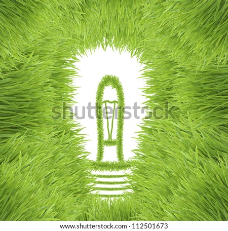 Light bulb made of green grass isolated on white background (ecological concepts) - stock photo