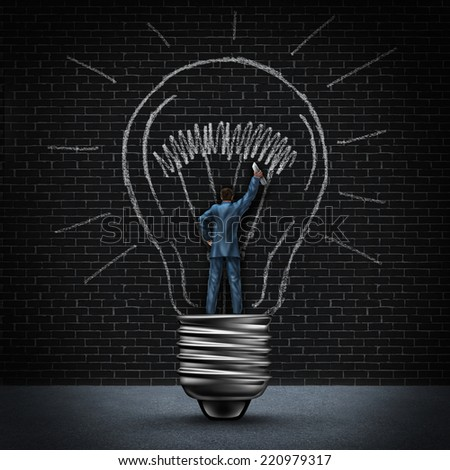 Light bulb man business concept as a businessman standing in a light base and drawing a glowing bulb using a piece of chalk as a symbol for creating your own solution through vision and imagination. - stock photo