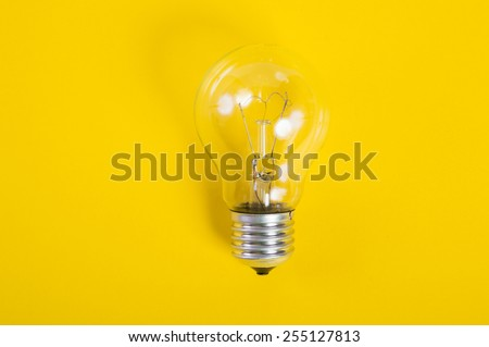 light bulb on a yellow background - stock photo