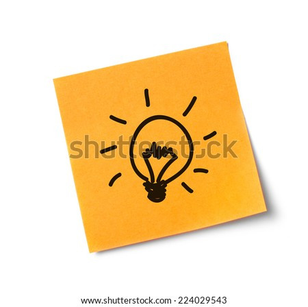 Light bulb on adhesive note Adhesive note on white background - stock photo