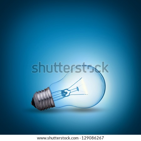 light bulb on blue background on the ground side - stock photo
